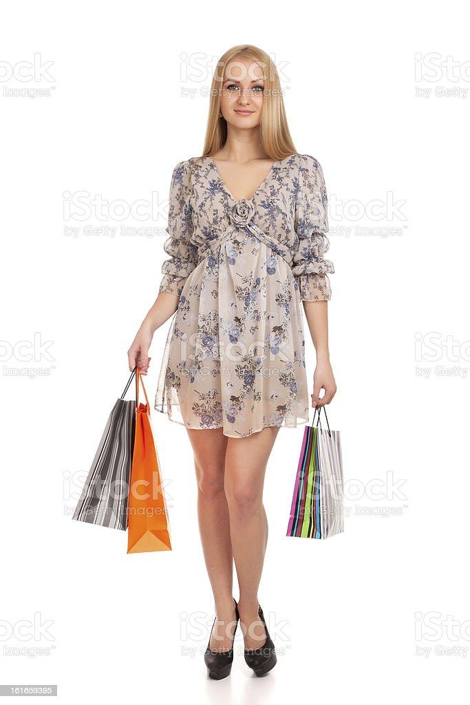 Beautiful blond woman holding shopping bags stock photo