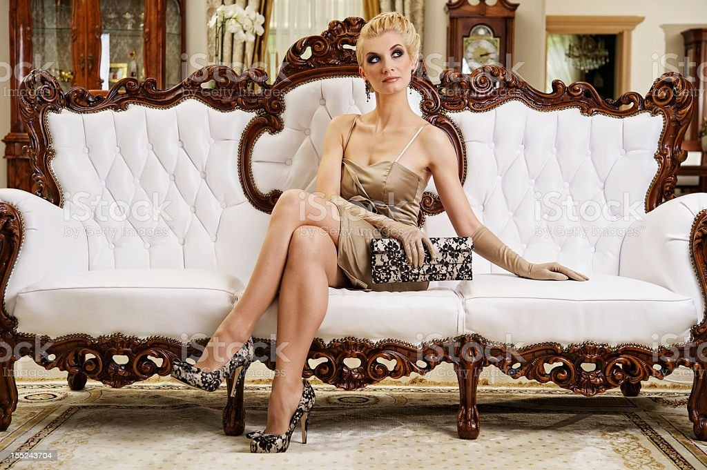 Beautiful blond woman in a luxury interior royalty-free stock photo
