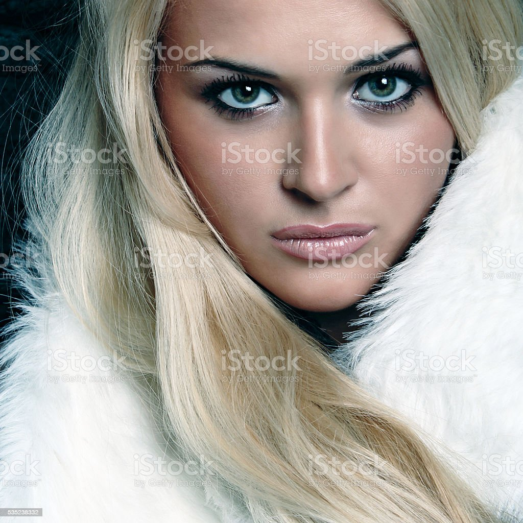 beautiful blond woman in fur. winter stock photo