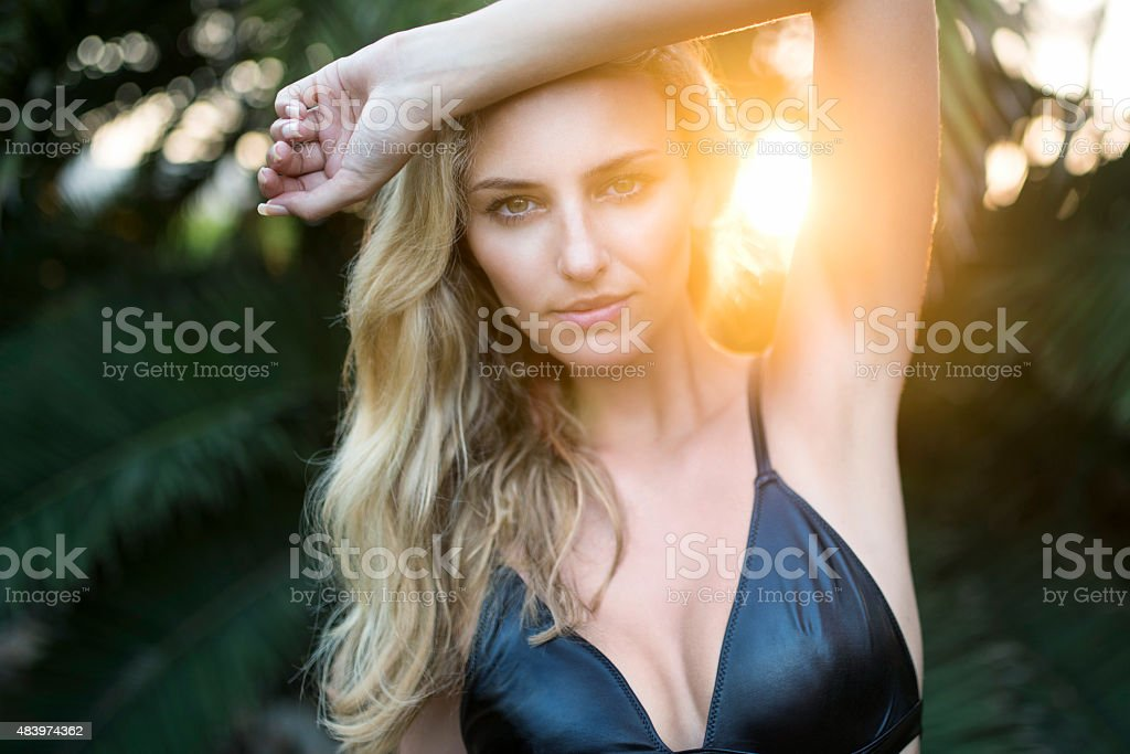 Beautiful blond woman, Intense Backlit Outdoor Portrait stock photo