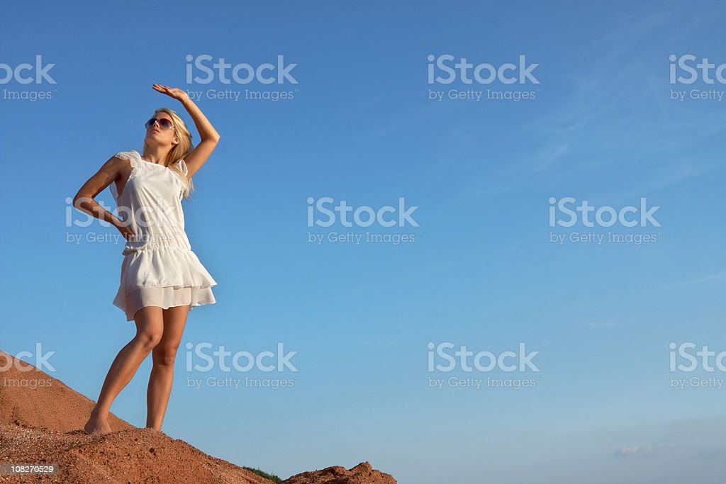 beautiful blond woman looking up royalty-free stock photo
