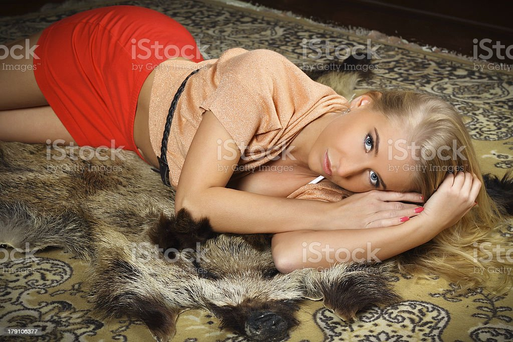 beautiful blond woman lying on the chateau carpet royalty-free stock photo