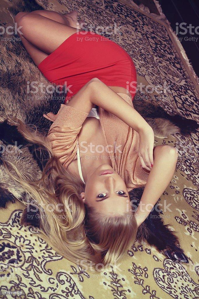 beautiful blond woman lying on the chateau carpet royalty-free stock photo