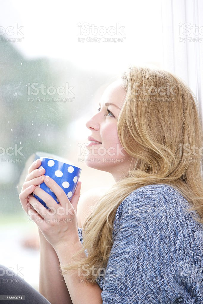 Beautiful blond woman relaxing royalty-free stock photo