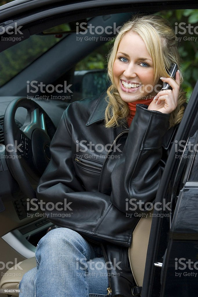 Beautiful Blond Woman Sitting In Her Car On Cell Phone royalty-free stock photo
