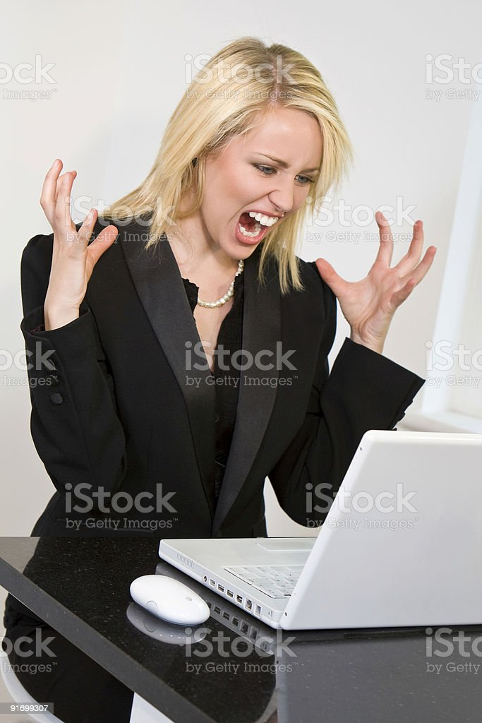 Beautiful Blond Woman Suffering Computer Crash on Her Laptop royalty-free stock photo