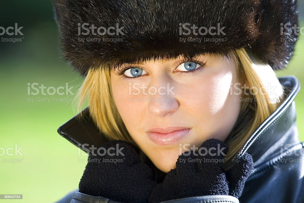 Beautiful Blond Woman With Blue Eyes in Black Fur Hat royalty-free stock photo