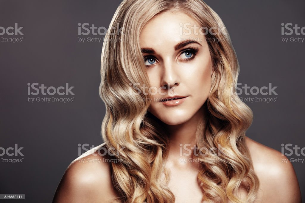 Beautiful blond woman with curly hair stock photo