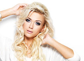 Beautiful blond woman with long curly hair and style makeup