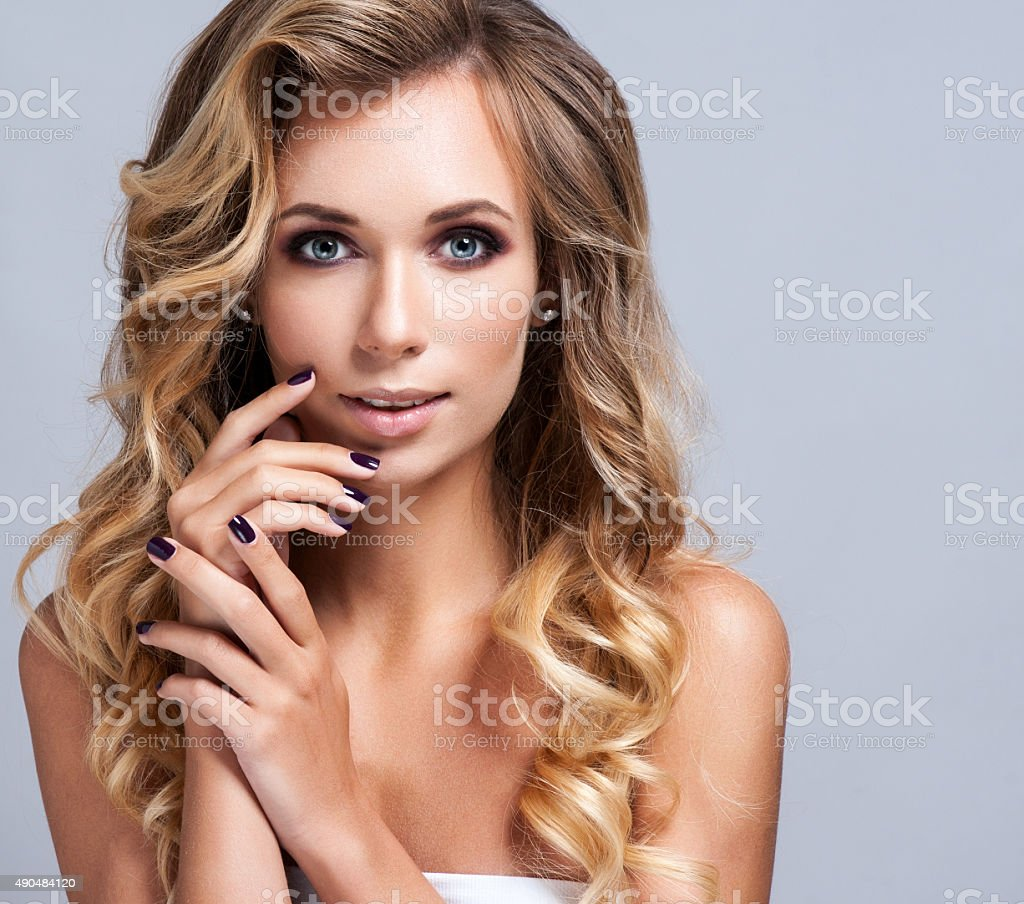 Beautiful blond woman with long curly hair stock photo
