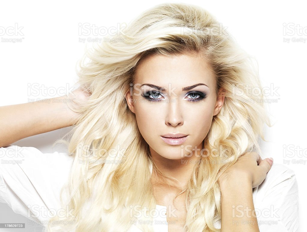 Beautiful blond woman with long hair stock photo