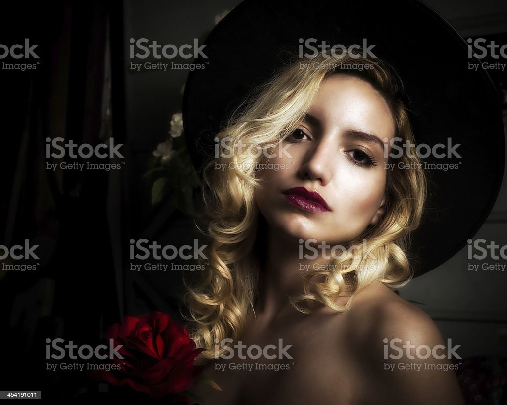 Beautiful Blond Woman with Red Roses royalty-free stock photo
