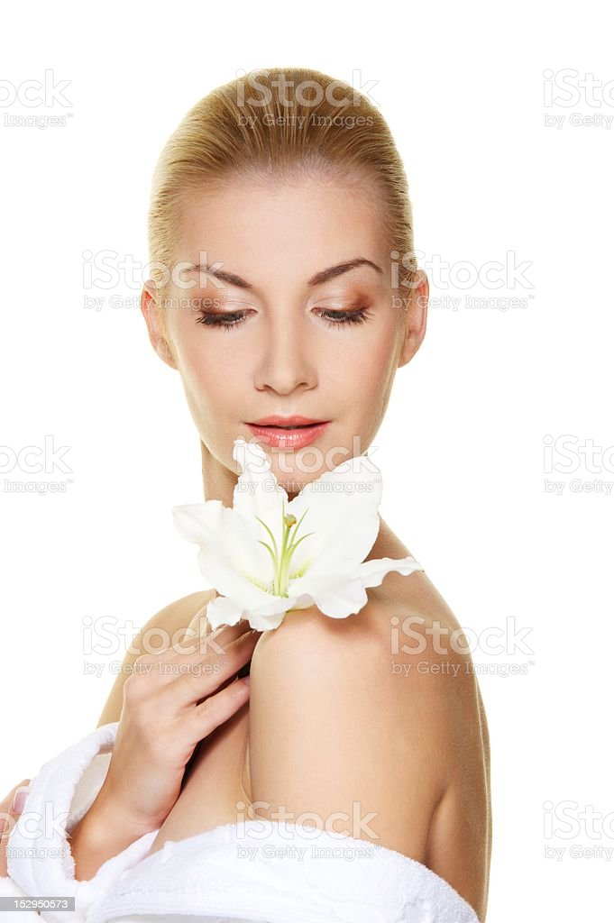 Beautiful blond woman with white lily flower royalty-free stock photo
