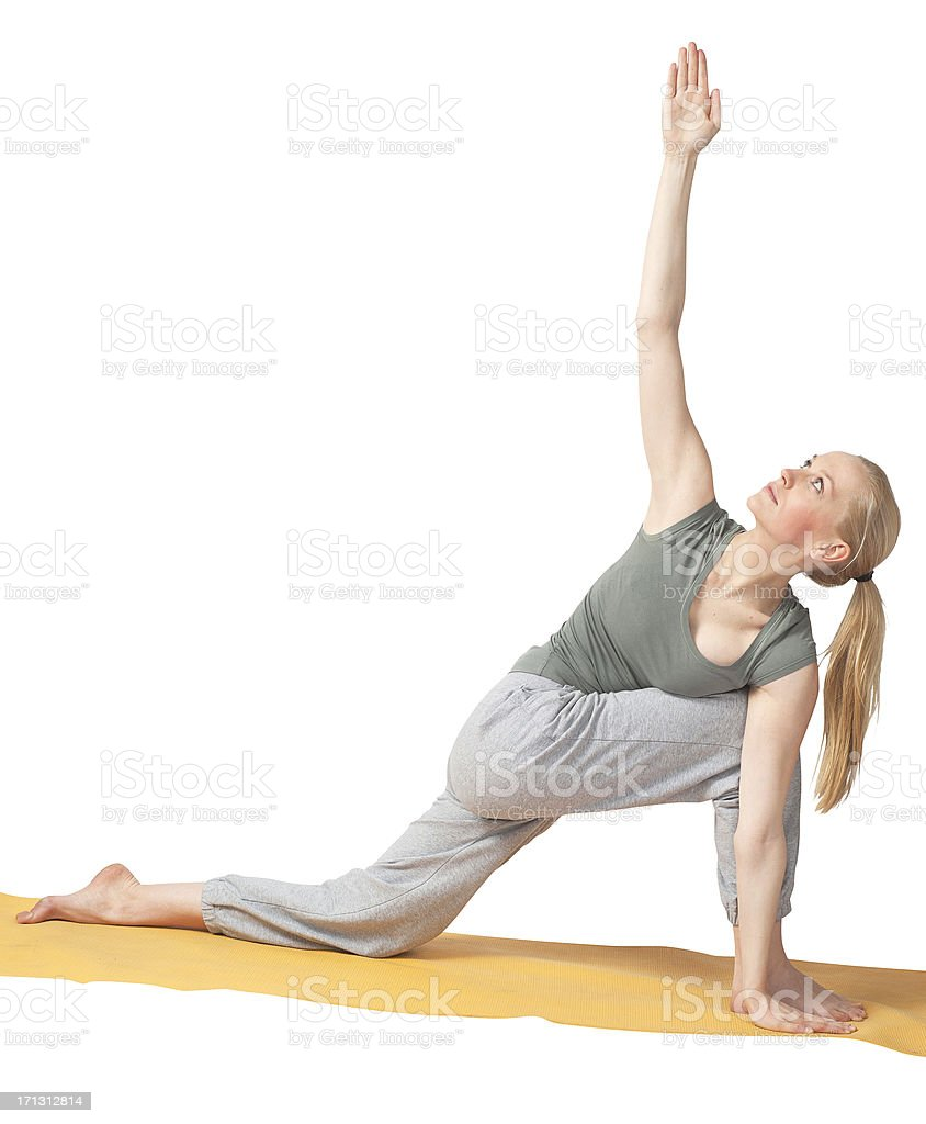 Beautiful blond woman with yellow yoga-mat isolated on white stock photo