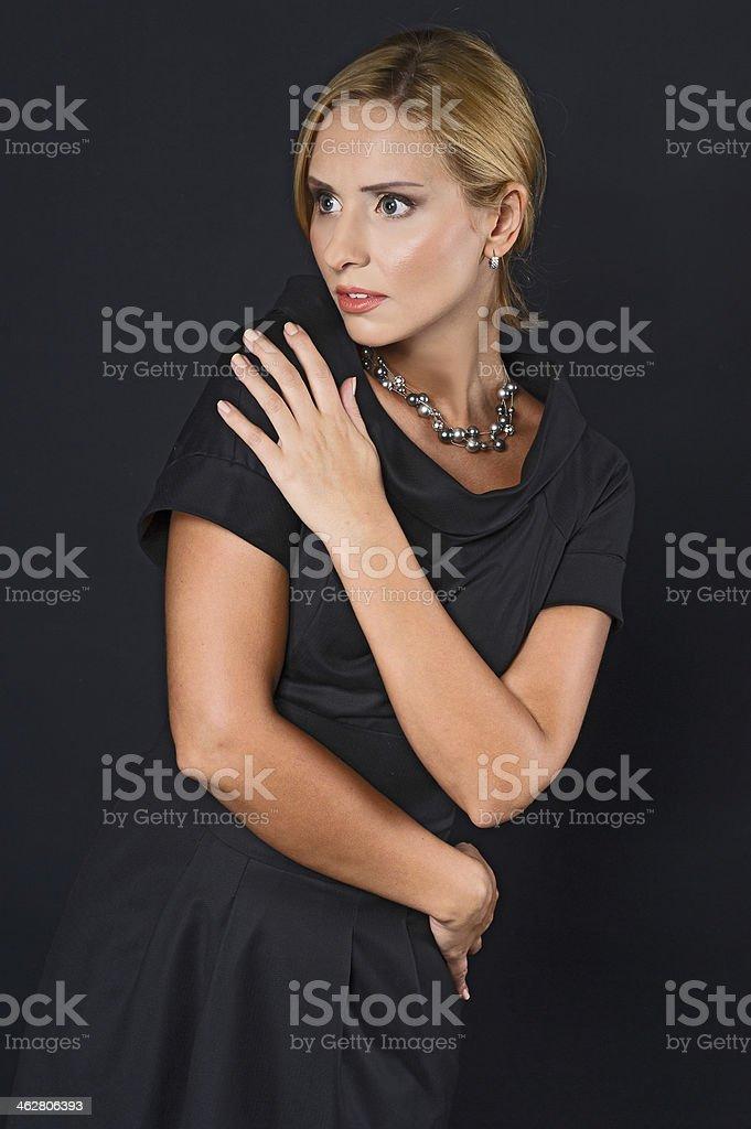 Beautiful Blond Women Looking Suspenseful stock photo