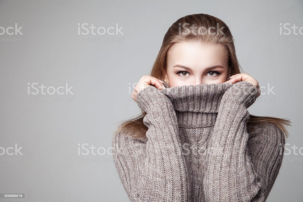 Beautiful blond young girl wears winter pullover stock photo