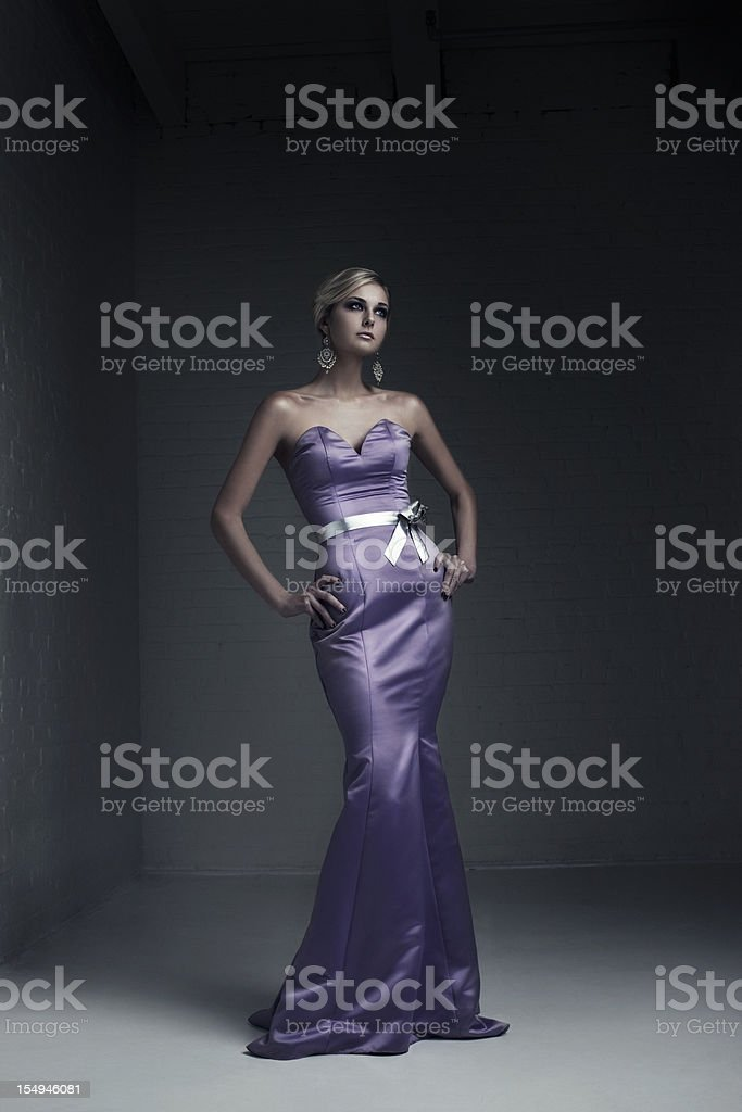 Beautiful Blond Young Woman Fashion Model in Evening Gown royalty-free stock photo