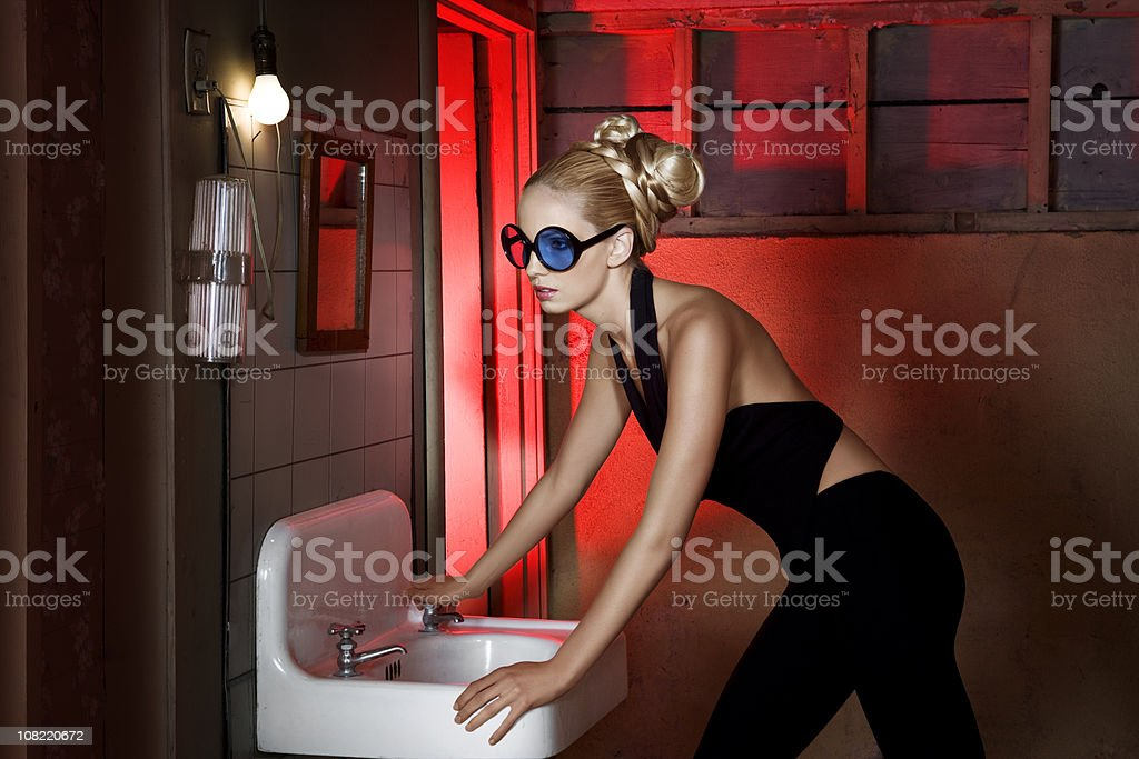 Beautiful Blond Young Woman Fashion Model with Updo in Basement royalty-free stock photo