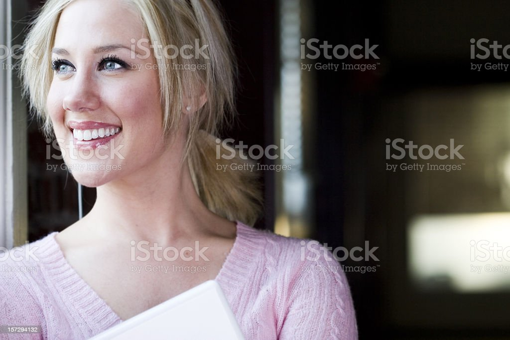Beautiful Blond Young Woman Portrait Holding Laptop, Copy Space royalty-free stock photo