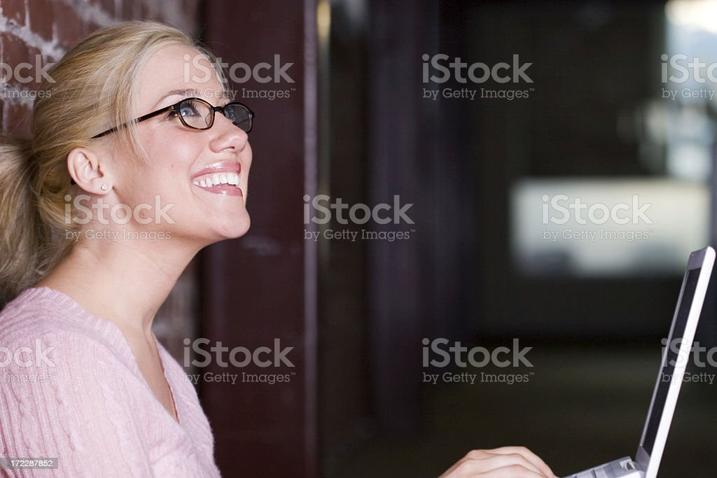 Beautiful Blond Young Woman Using Laptop at Office, Copy Space royalty-free stock photo