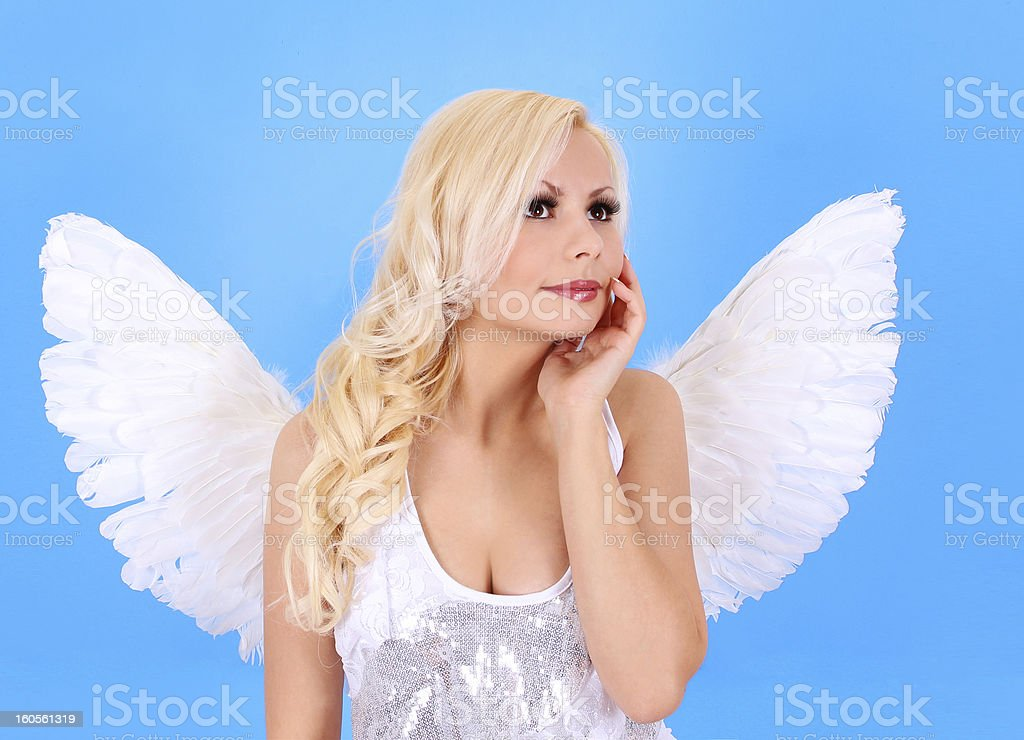 beautiful blonde angel girl over blue background royalty-free stock photo