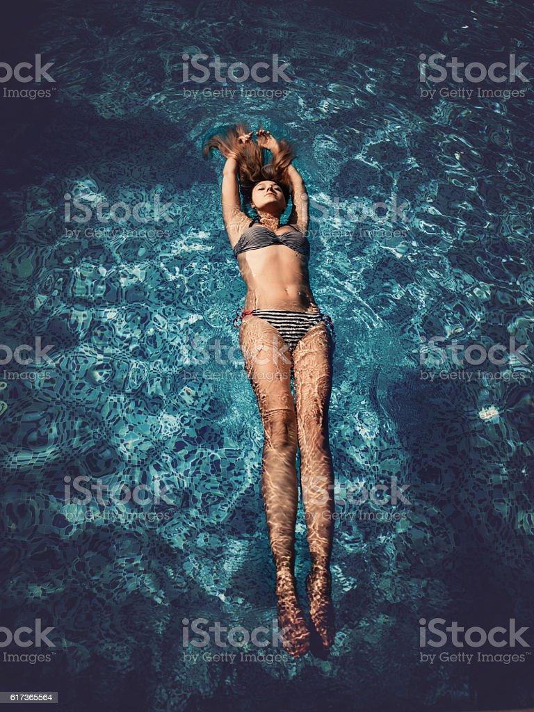 Beautiful blonde at pool stock photo