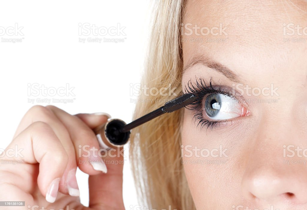 beautiful blonde brushing her eyelash stock photo