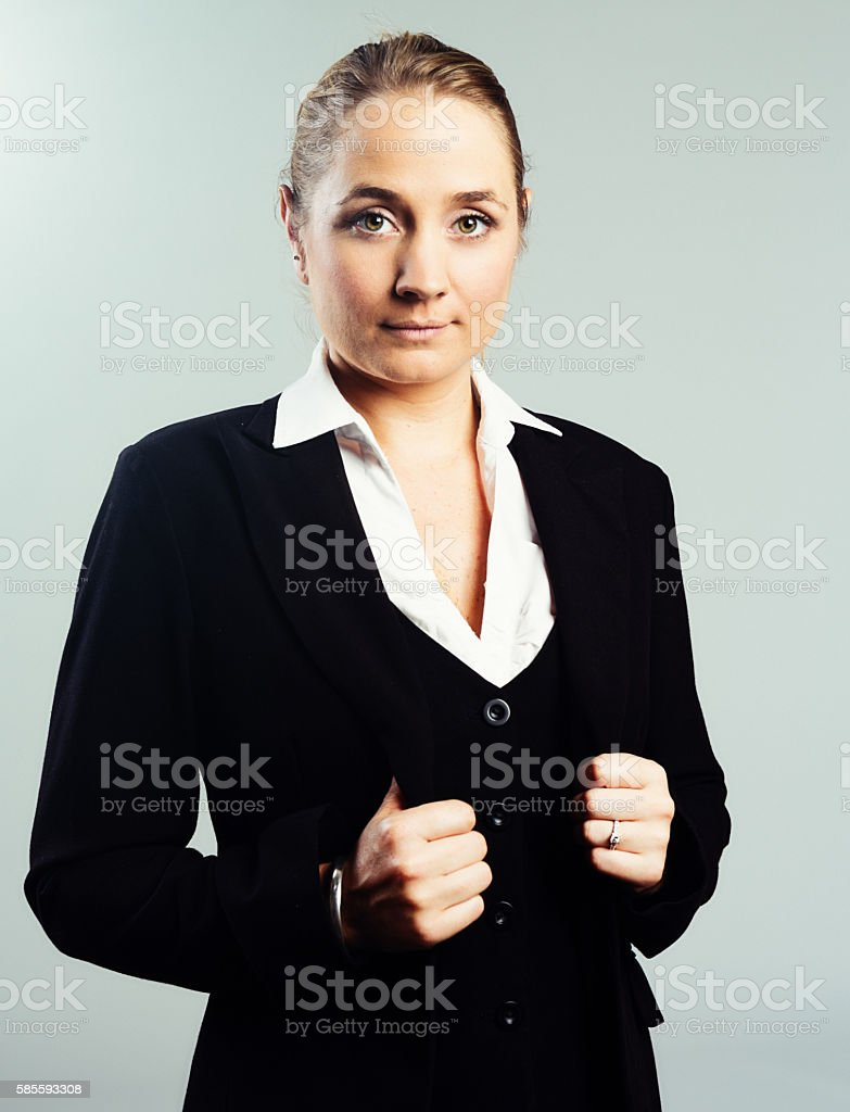 Beautiful blonde businesswoman looks serious, confident and challenging stock photo