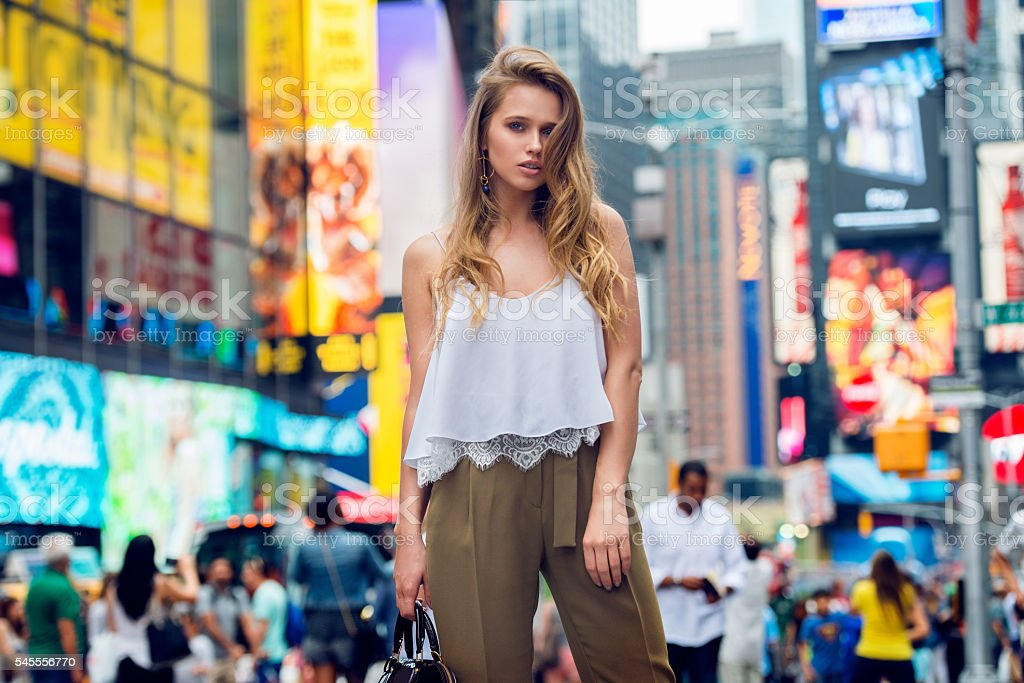 Beautiful blonde fashionable model girl standing in New York City stock photo
