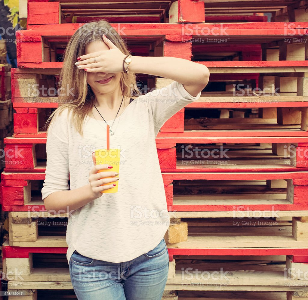 Beautiful blonde girl closes her eyes stock photo