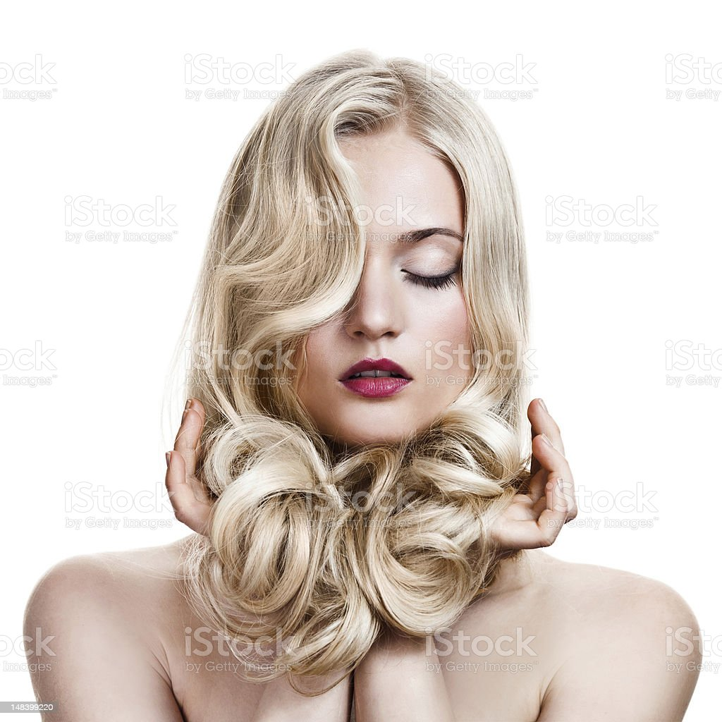 Beautiful Blonde Girl. Healthy Long Curly Hair. stock photo