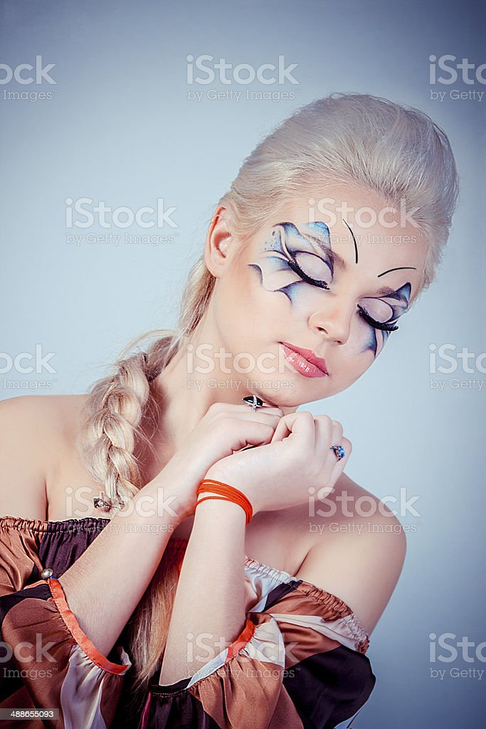 Beautiful blonde girl. Healthy long hair and makeup Entertainment royalty-free stock photo