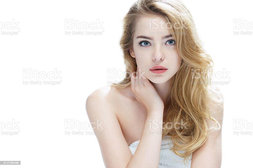 Beautiful blonde girl on white background. stock photo