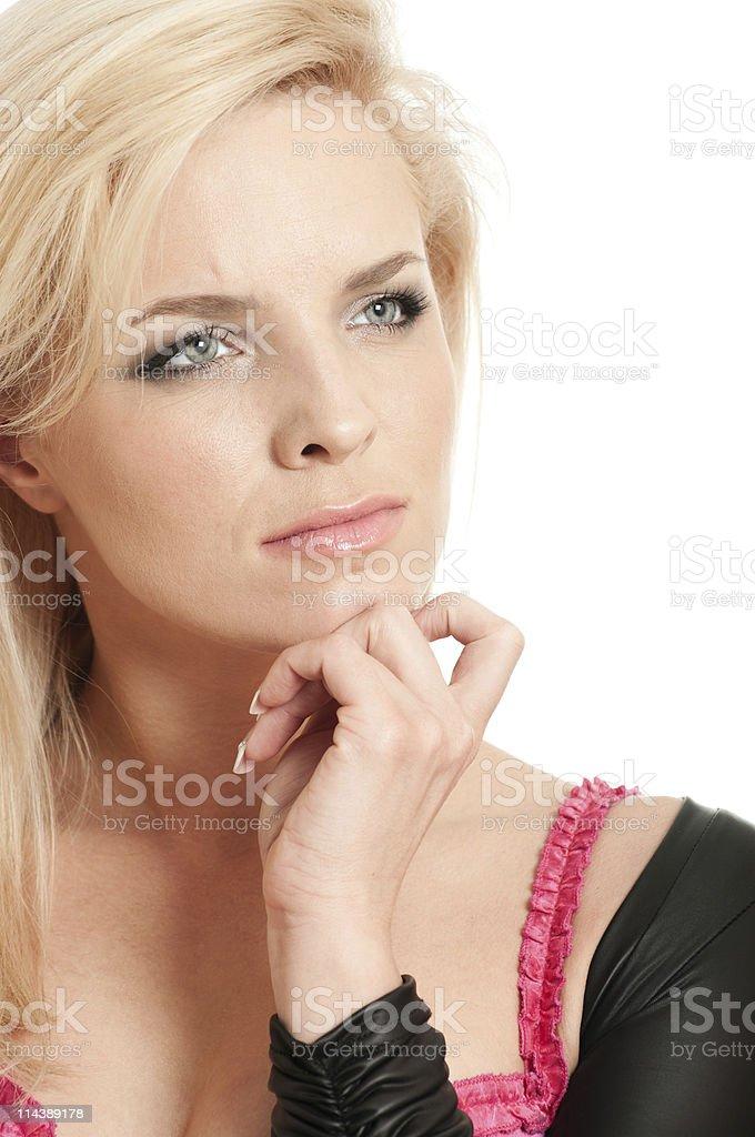 Beautiful blonde girl thinking holding a chin stock photo