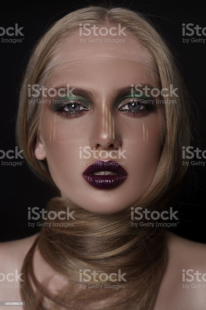 Beautiful blonde girl with colourful make-up and transparent mask stock photo