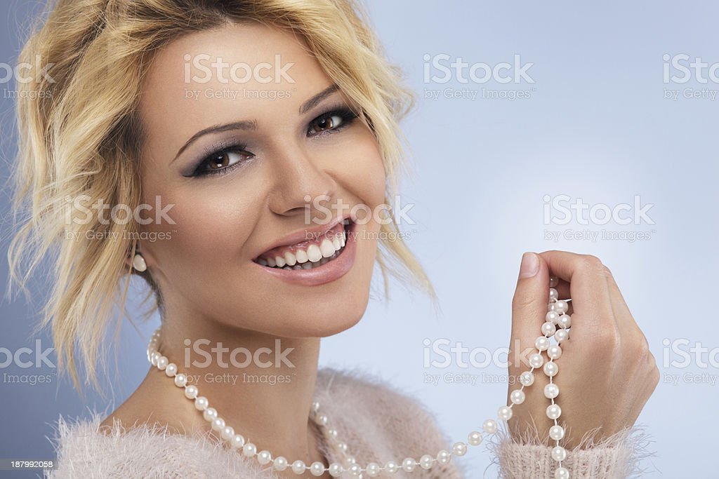Beautiful blonde girl with Pearls stock photo