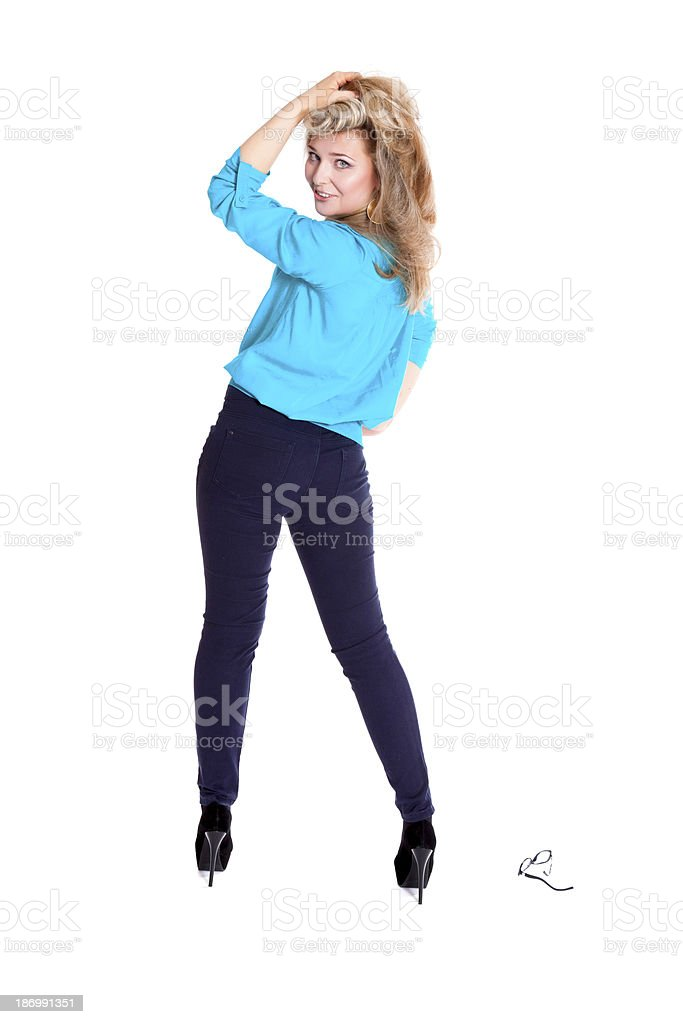 Beautiful blonde in a blue blouse and trousers royalty-free stock photo