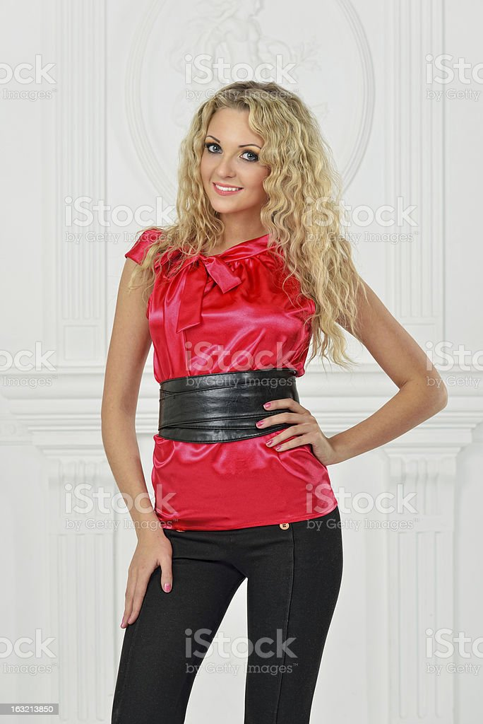 Beautiful blonde in red blouse. royalty-free stock photo