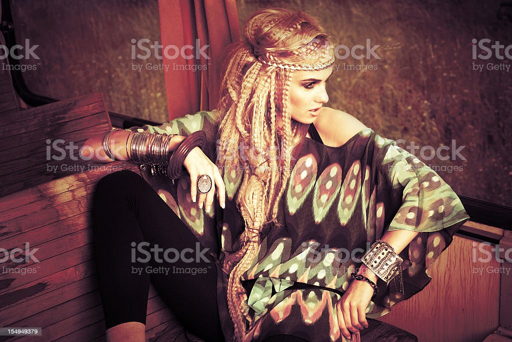 Beautiful blonde in vintage train stock photo