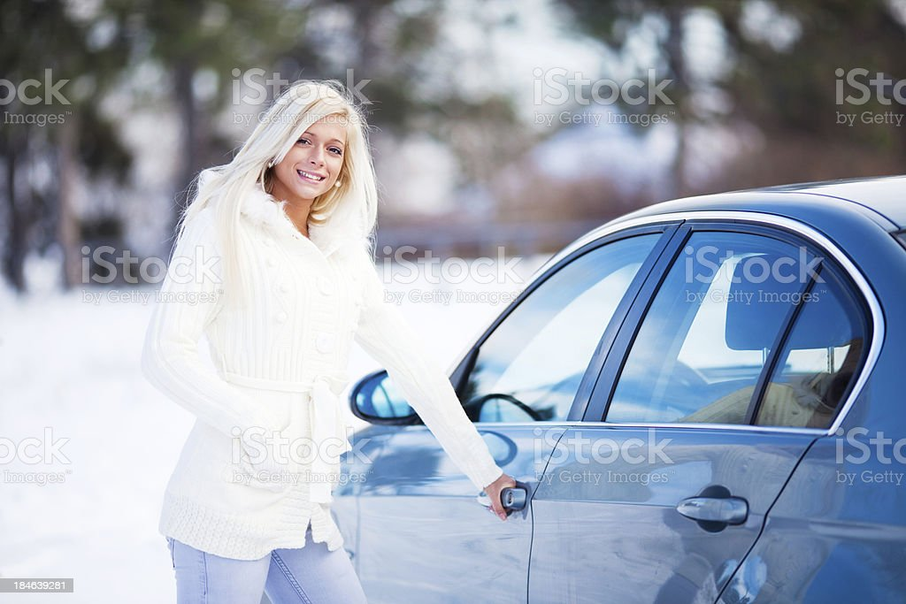 Beautiful blonde lady entering her car. royalty-free stock photo