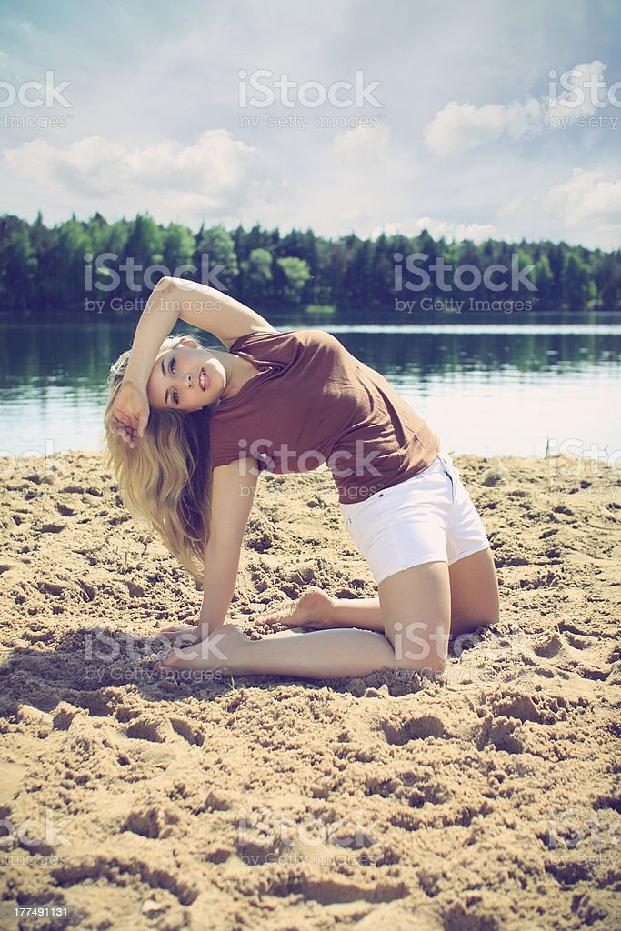 Beautiful blonde on a beach royalty-free stock photo
