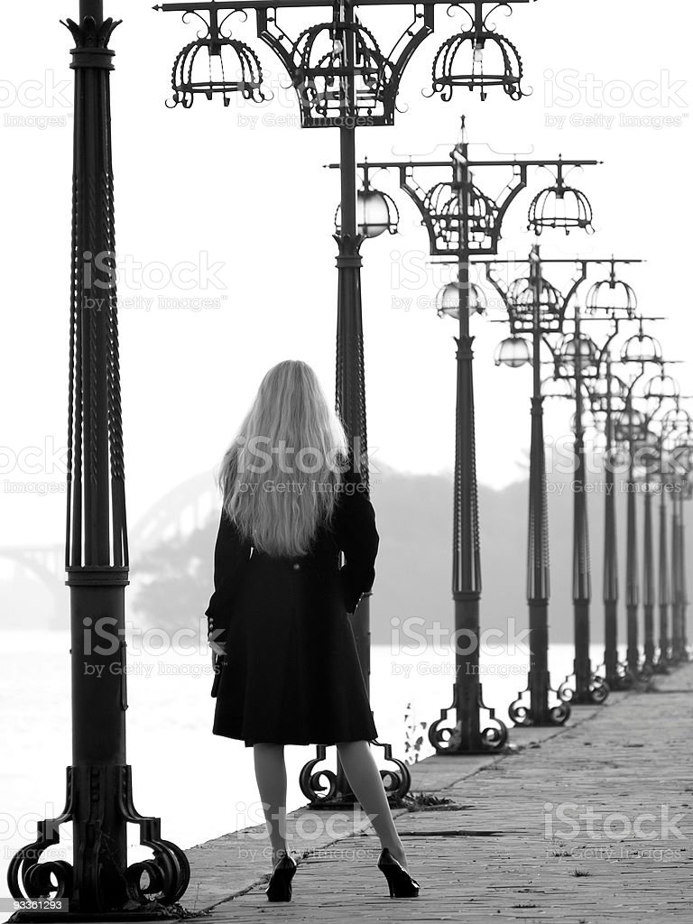 Beautiful blonde on promenade royalty-free stock photo