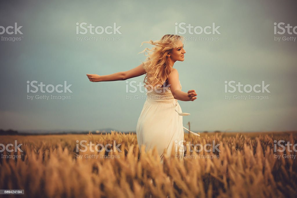 Beautiful blonde on the field stock photo