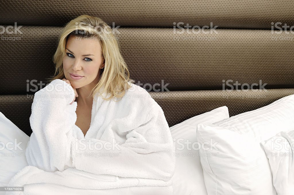 Beautiful Blonde Relaxing In Bed royalty-free stock photo