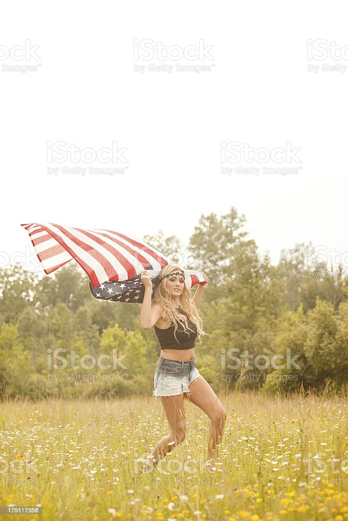 Beautiful Blonde Teenager Holding American Flag stock photo