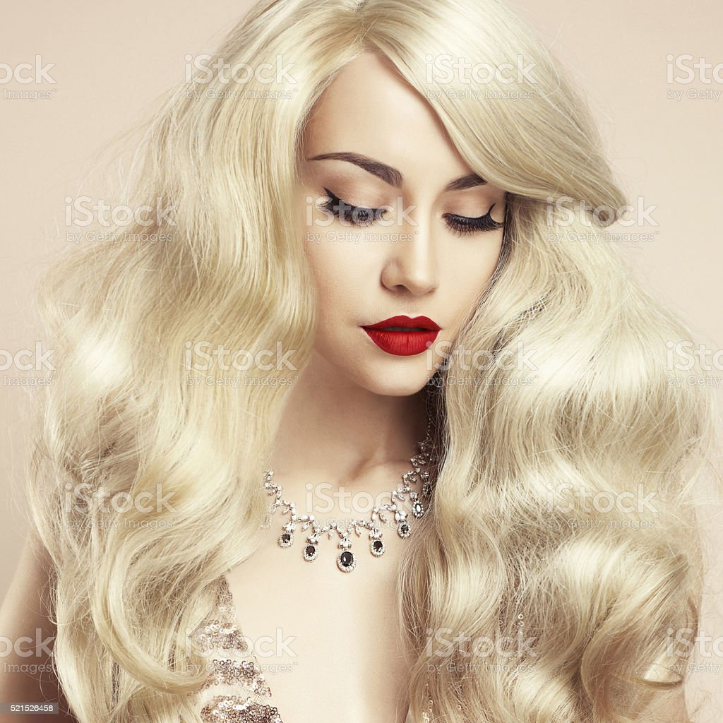 Beautiful blonde with magnificent hair stock photo
