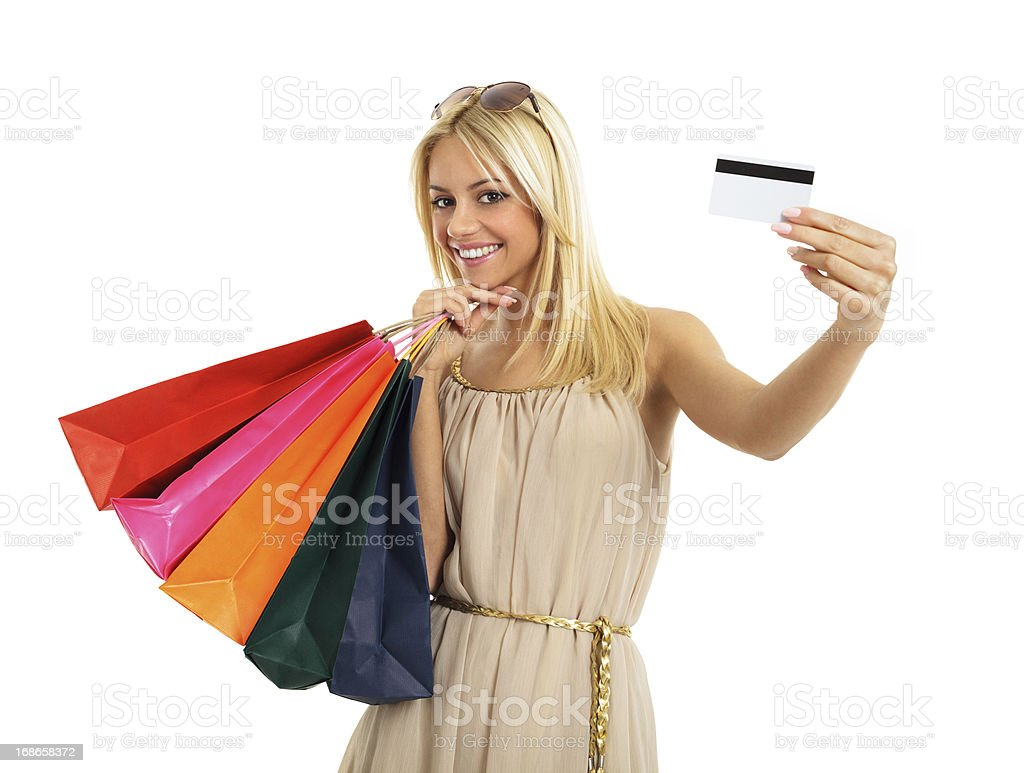 Beautiful blonde with shopping bags and credit card royalty-free stock photo