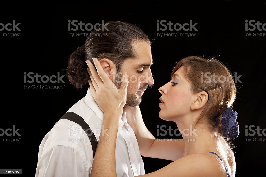 Beautiful blonde woman about to kiss a man stock photo