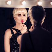 Beautiful Blonde Woman Apply Lipstick Looking Into Mirror