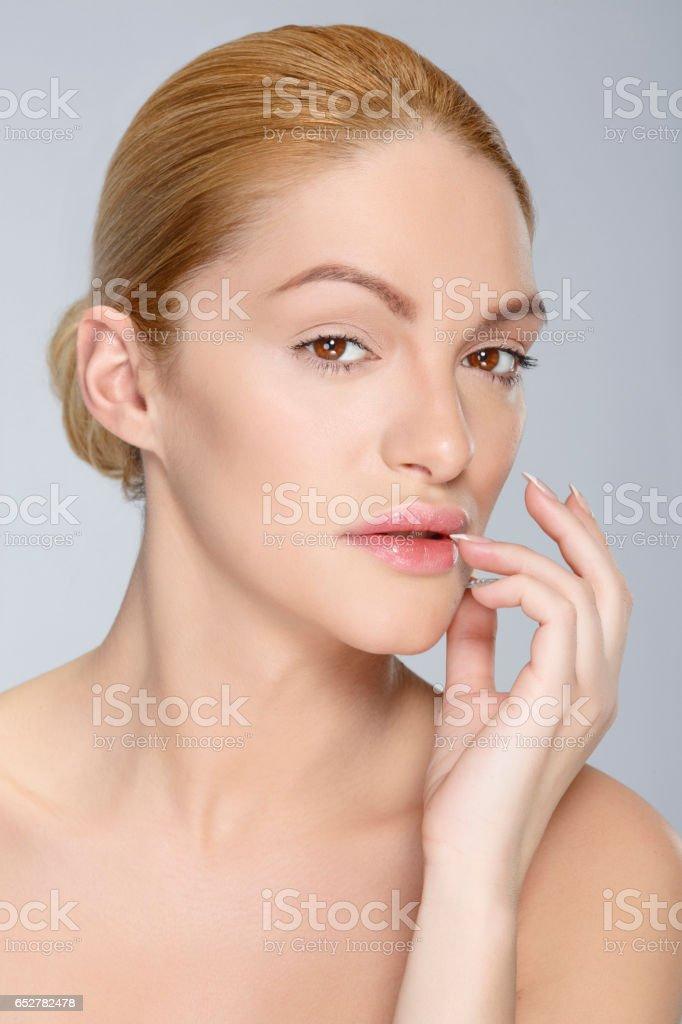 Beautiful blonde woman Beauty Headshot Woman looking at camera stock photo